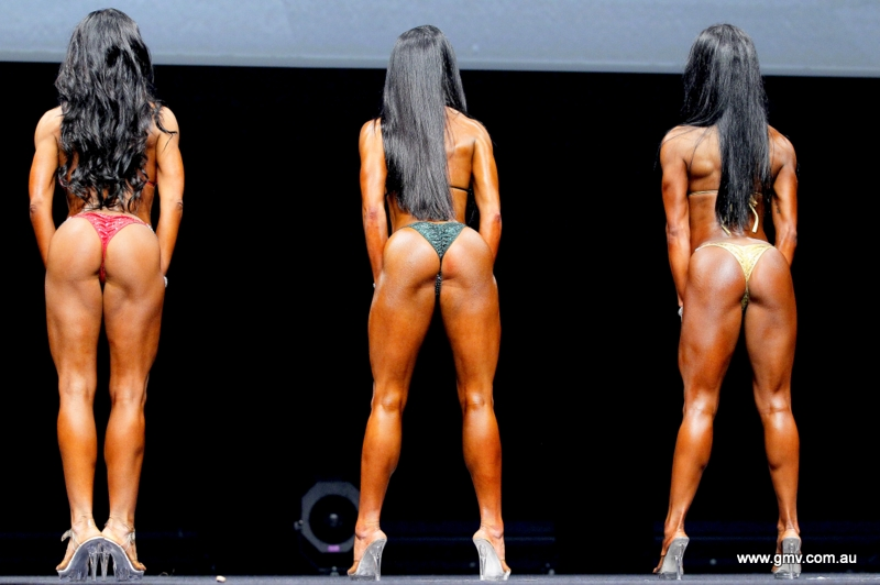 Pro female bodybuilder poses and shows off her physique - 5 8